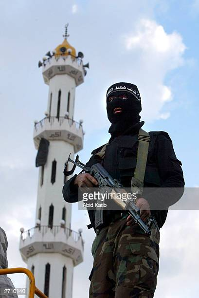 Masked gunman from the Al Aqsa martyrs brigade stands guard during the funeral of Mahmoud Abu Shkel and Shadi Habub November 8 2003 in the Beit Lahia...