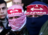 Masked gunmen attend a press conference while Abu Thaer a Palestinian spokesman of the AlAqsa Brigades the military wing of the Palestinian president...