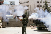 A masked Hamas militant shoots an RBG rocket against the headquarters of the Preventative Security Force loyal to the Palestinian president Mahmoud...