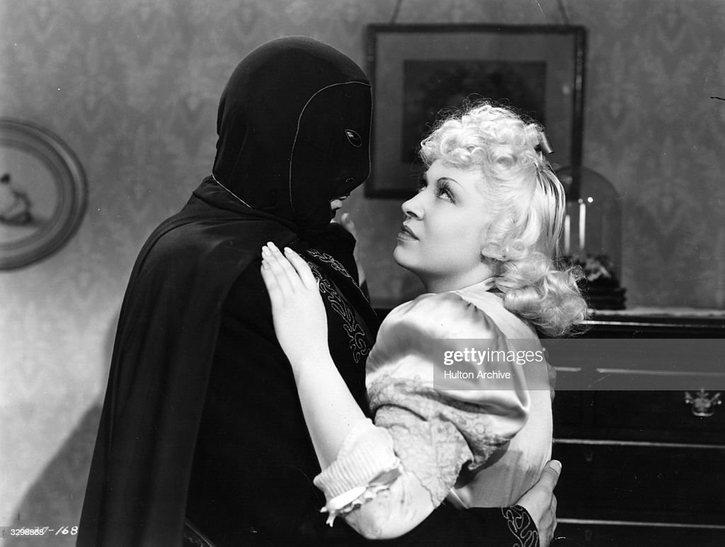 A masked Joseph Calleia (1897-1975) embraces Mae West (1892-1980) in a scene from 'My Little Chickadee', directed by Edward F Cline for Universal.