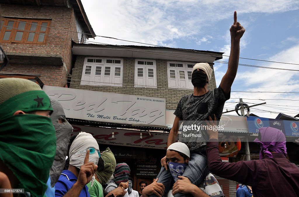 A masked Kashmiri Muslim protester Shouts Profreedom slogans during a demonstration in Old city Srinagar on August 31 2016 Protests erupted in...