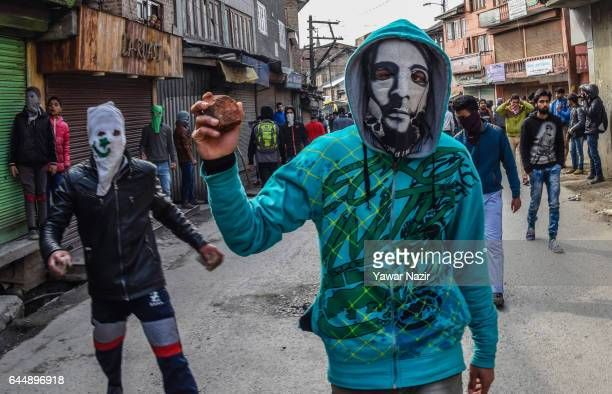 Masked Kashmiri Muslim protesters hold stones and bricks before throwing them at Indian government forces during an anti India protest on February 24...