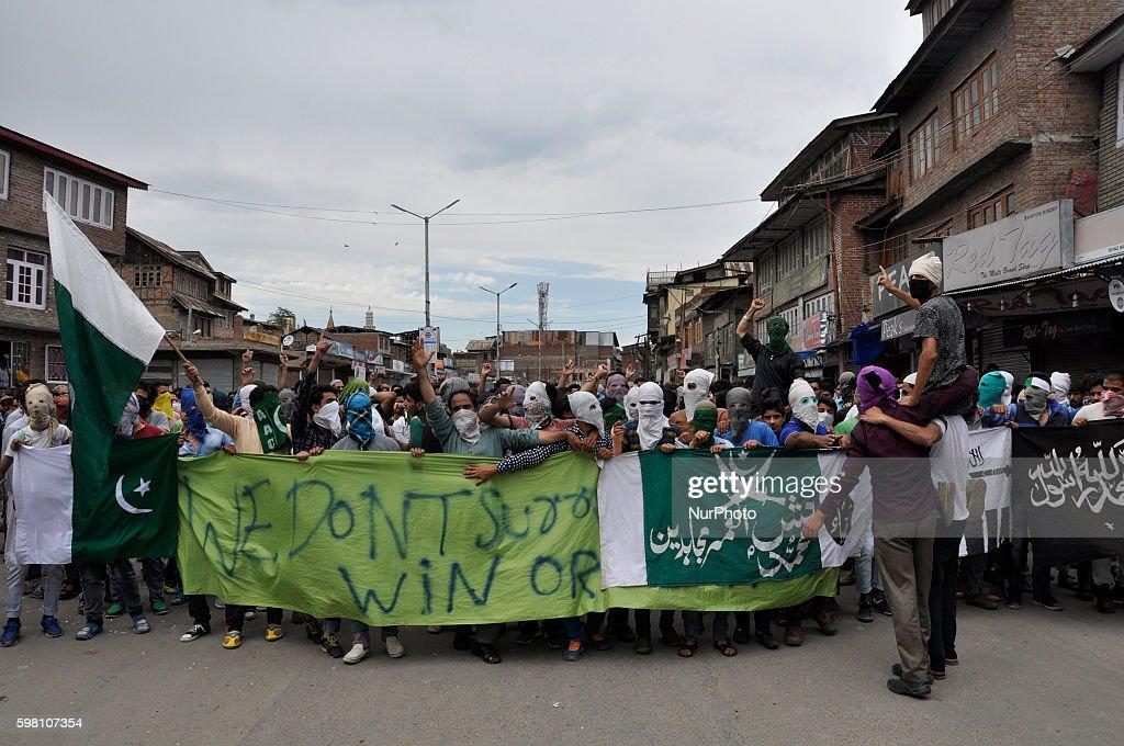 Masked Kashmiri Muslim Protesters Shout Profreedom slogans during a demonstration in Old city Srinagar on August 31 2016 Protests erupted in Kashmir...
