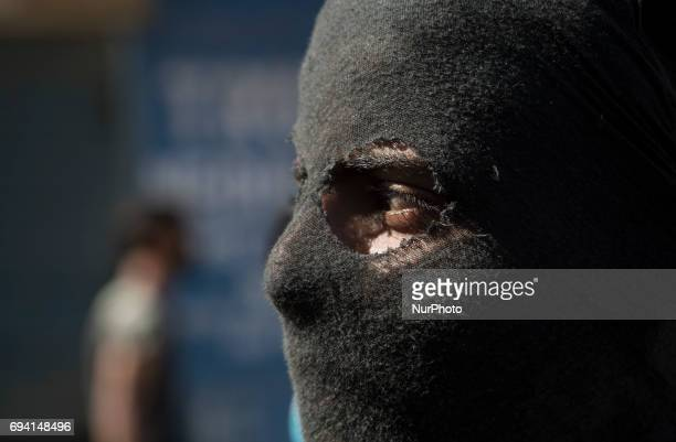 A masked Kashmiri protester looks upon during a protest Friday June 9 in Srinagar Indianadministered Kashmir India Profreedom leaders in Kashmir had...