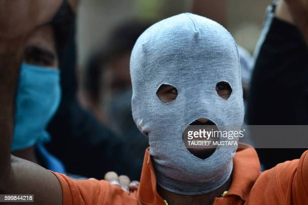 TOPSHOT Masked Kashmiri protestors shout profreedom and antiIndia slogans during a protest against civilian killings in Kashmir's ongoing summer...