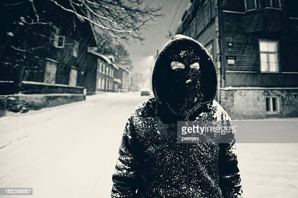 masked man, dark alley