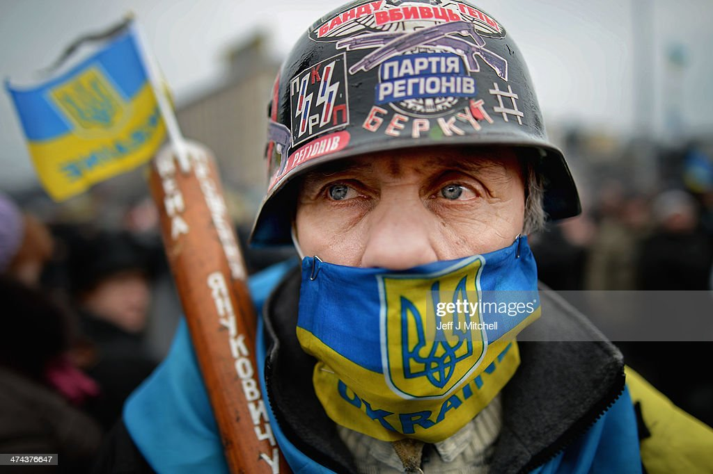 A masked man stands in independence square on February 23, 2014 in Kiev, Ukraine. Prime Minister Yanukovych is said to have left Kiev for a eastern stronghold as the country's parliament voted to remove Yanukovych from office and call for new elections.