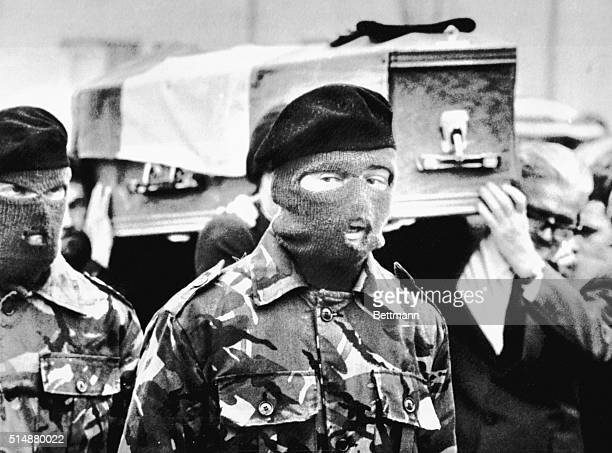 Masked members of an IRA honor guard bear the coffin of hunger striker Bobby Sands to his grave He and nine other prisoners in Belfast's Crumlin Road...