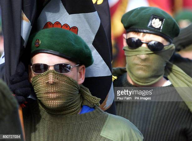Masked members of the Ulster Defence Association on parade in North Belfast They were part of a remembrance parade in memory of UDA member Tommy...