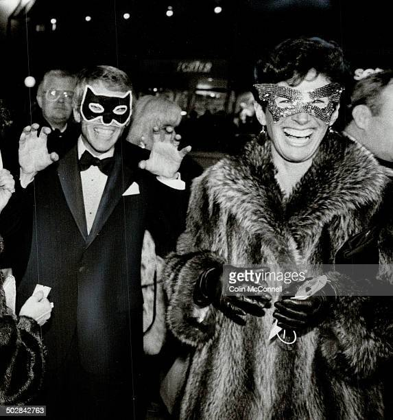 Masked merrymakers The atmosphere was lighthearted at the Elgin Theatre last night when the city's business political and social elite put on their...
