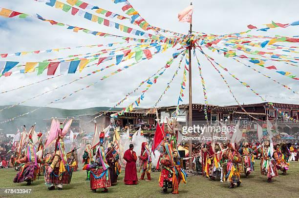 Masked Monks Dancing At A Tibetan Festival