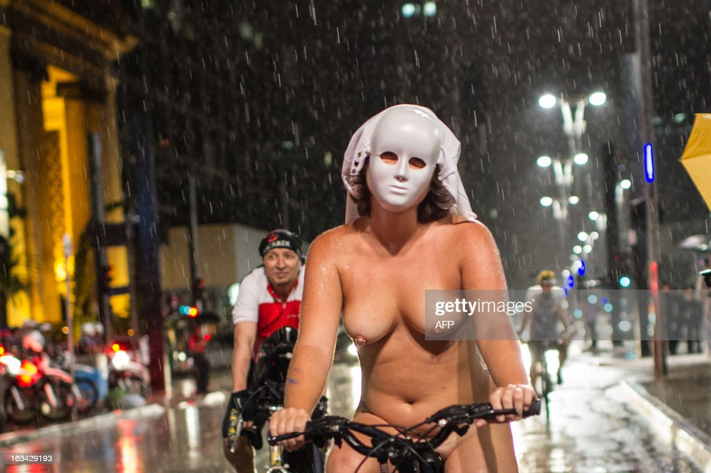 A masked naked cyclist takes part in the 6th 'Naked Pedalling', an annual cycling event, at Paulista Avenue in Sao Paulo, Brazil, on March 9, 2013. The event welcomes naked cyclists to celebrate cycling and the human body and protest against cars, gas emission and agressive drivers. AFP PHOTO/Yasuyoshi CHIBA