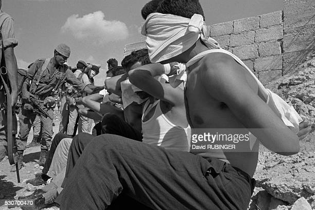 Masked Palestinain prisoners captured during an Israeli operation to uncover and capture members of the Movement for the National Liberation of...