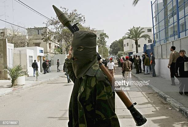 A masked Palestinian gunmen holds an RPG outside the European Union Office on March 14 2006 in Gaza City Gaza Strip Hundreds of Palestinians stormed...