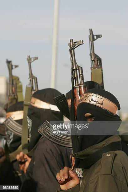 Masked Palestinian gunmen stand out side a polling station for Fatah movement after they closed it November 28 2005 at the Khan younis camp in...