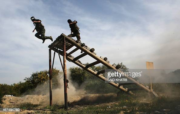 Masked Palestinian militants of alAqsa Martyrs' Brigades a group linked to the Fatah movement demonstrate their skills during a training in Rafah...