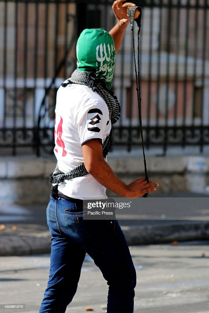 A masked Palestinian youth, wearing Hamas insignia gets ready to hurl a stone at Israeli soldiers. The Islamic Jihad faction organized protests in solidarity with Gaza, in the West Bank city of Bethlehem. As ceasefire talks collapsed completely in Cairo earlier this week, and fighting renewed on Wednesday. Hamas launched a barrage of rockets towards Southern Israel, some reaching as far as Jerusalem and illegal Israeli settlements in the West Bank, some 80 kilometers away from Gaza. Late Tuesday evening an Israeli missile struck the home of Hamas military commander Muhammad Deif, killing his wife and three-year-old daughter. Deif, according to Hamas reports was not assassinated. On Thursday, three more to military commanders, Muhammad Abu Shammala, Raed al-Attar and Muhammad Barhoum were also killed in airstrikes. In response, Hamas killed what they believed to be collaborators with Israel in Gaza. 18 suspected of having worked with Israeli army intelligence have been killed so far. Late Friday afternoon, a four-year-old Israeli child from Nihal Oz was killed by mortar fire from Gaza. To date, the death toll from the Gaza war stands at 2090 Palestinians and 67 Israelis.