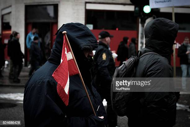 Masked PEGIDA activist with Danish flag Clashes between antiislamist protesters and antifascist activists broke out in Copenhagen Denmark on 23...