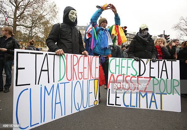 Masked people attend the forbidden COP21demonstration on November 29 2015 in Paris FranceThe demonstration was banned after the Paris terror attacks...