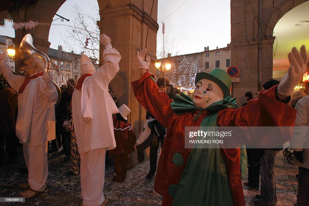 Masked people perform in the historical centre of Limoux, southern France, on January 6, 2013, as they take part in the city's carnival, which started on January 6 and will end on March 17. AFP PHOTO / RAYMOND