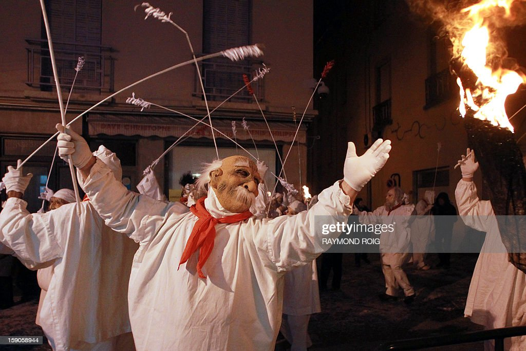 Masked people perform in the historical centre of Limoux, southern France, on January 6, 2013, as they take part in the city's carnival, which started on January 6 and will end on March 17. AFP PHOTO / RAYMOND ROIG