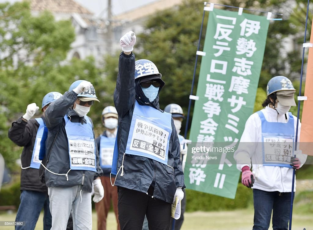 Masked people stage a protest in the Japanese city of Shima on May 26, 2016 against the Group of Seven summit, calling it a meeting to plot a war in the name of fighting terrorism.