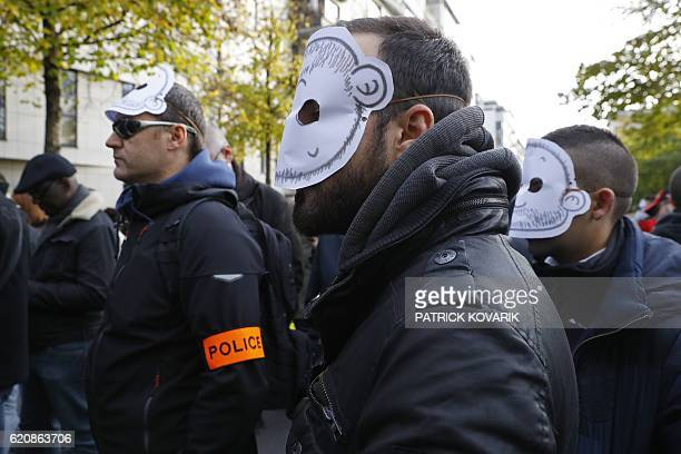 TOPSHOT Masked policemen take part in a protest outside the headquarters of the Inspection Generale de la Police Nationale a subdirectorate...