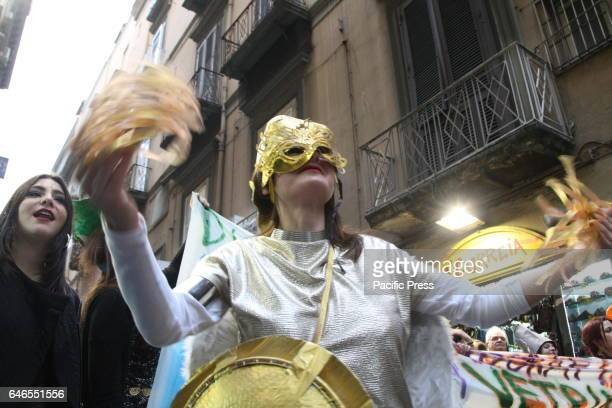 Masked procession in the old part of Naples in the day of the Mardi Gras parade through the streets of downtown