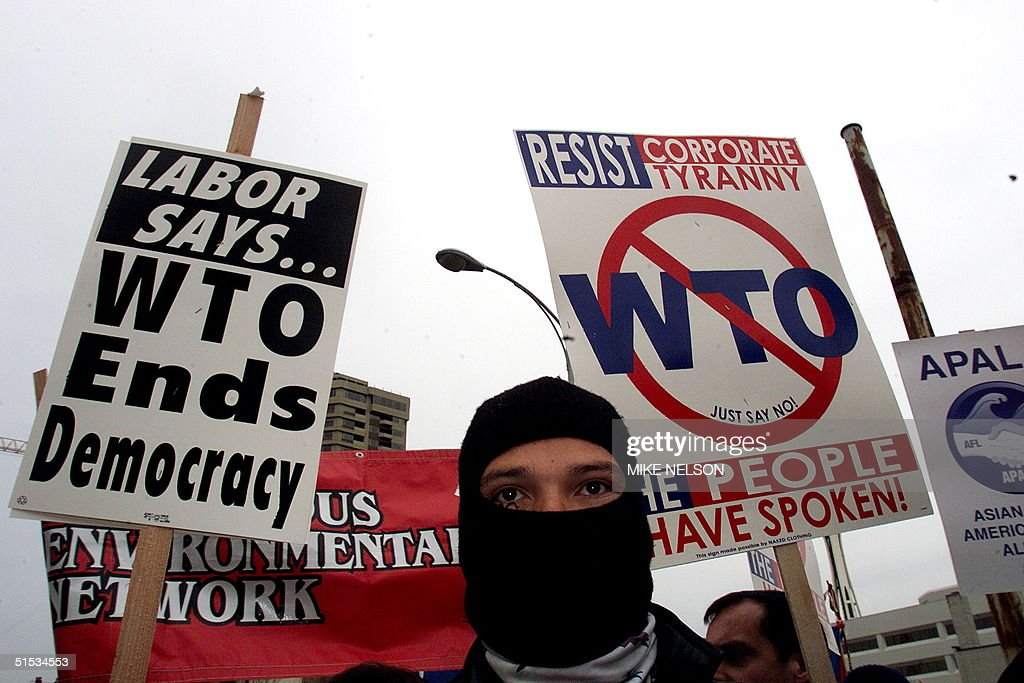 A masked protester joins an antiWorld Trade Organization rally that includes labor environmental and farmer workers groups together 03 December 1999...