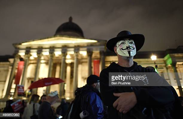 A masked protester stands in front of the National Portrait Gallery ahead of the Million Mask March in Trafalgar Square on November 5 2015 in London...