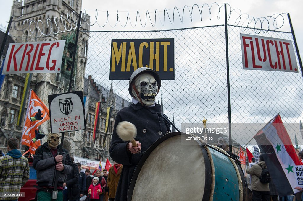 A masked protester takes part in a demonstration against the Munich Security Conference on February 13, 2016 in Munich, Germany. The annual event brings together government representatives and security experts from across the globe and this year the conflict in Syria will be the main issue under discussion.