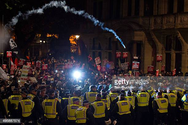 Masked protesters are stopped by a police line during the Million Mask March on November 5 2015 in London England The annual antiestablishment...