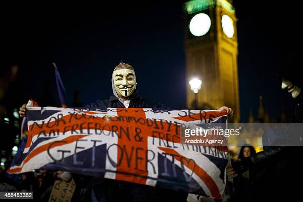 Masked protesters taking part at the 'Million Mask March' demonstration organised by activists Anonymous in London England on November 5 2014 The...