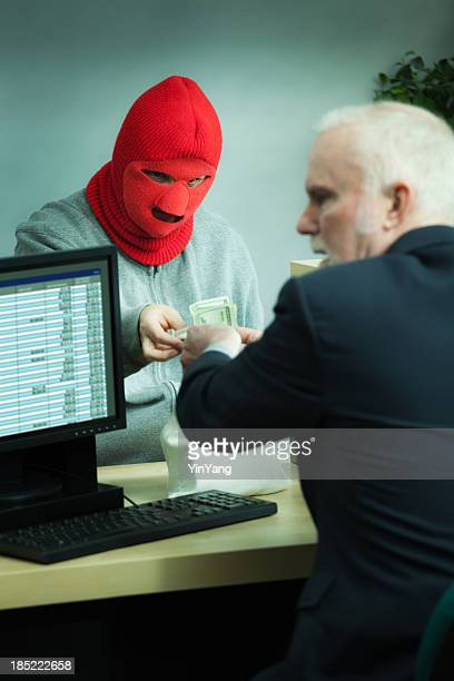 Masked Robber Robbing a Retail Bank Counter with Teller Vt