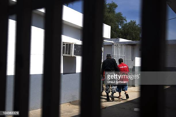 Masked security police transfer new inmates to prison where thousands of inmates are detained in Culiacan Sinaloa July 06 2009 The Culiacan prison is...