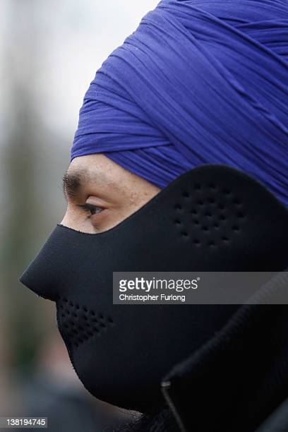 A masked Sikh member of the English Defence League takes part in a demonstration through the streets of Leicester on February 4 2012 in Leicester...