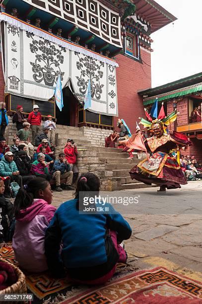 Masked temple dancer