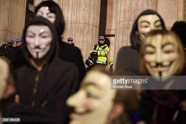 Masked up members of Anonymous in front of the cathedral being wathed by police further up the stepsThe London Stock Exchange was attempted occypied...