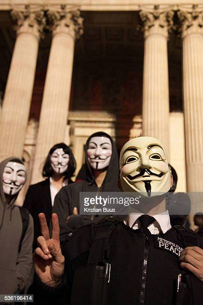 Masked up members of Anonymous in front of the cathedral The London Stock Exchange was attempted occypied in solidarity with Occupy Wall in Street in...