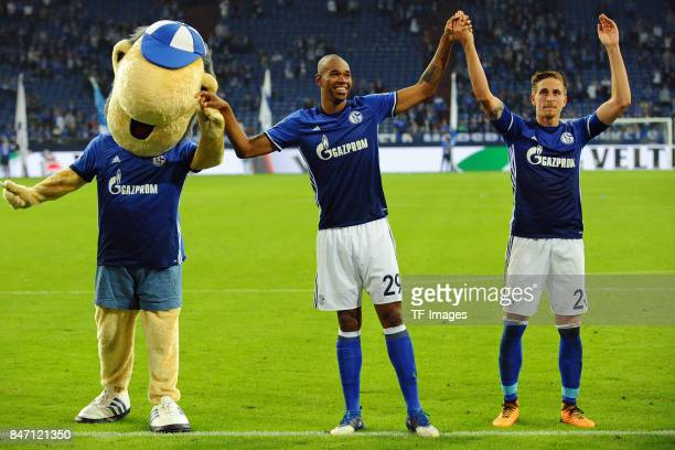 Maskottchen Erwin Naldo of Schalke and Bastian Oczipka of Schalke looks on during the Bundesliga match between FC Schalke 04 and VfB Stuttgart at...