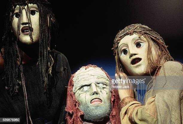 Masks adorn Alan Howard Clare Swinburne and Tanya Moodie in a National Theatre production of 'The Oedipus Plays'
