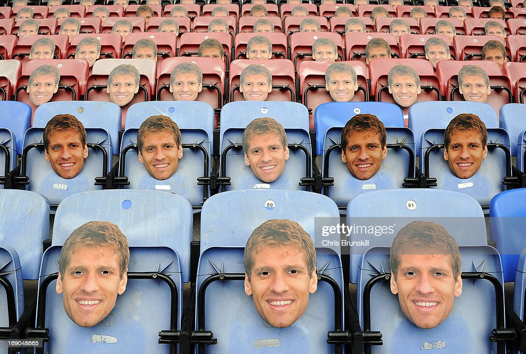 Masks of Stiliyan Petrov of Aston Villa are seen on seats ahead of the Barclays Premier League match between Wigan Athletic and Aston Villa at DW Stadium on May 19, 2013 in Wigan, England.