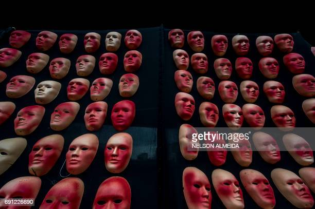 Masks one for each of the 594 congressmen and one more for Brazilian President Michel Temer put by the Brazilian NGO Rio de Paz as a protest against...