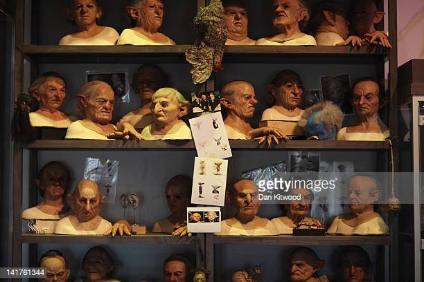 Masks worn by actors who played goblins at Gringotts Bank in the Harry Potter Films are displayed at the new Harry Potter Studio Tour at Warner...