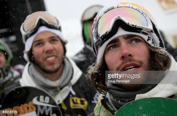 Mason Aguirre of the USA and Danny Davis of the USA watch fellow competitors during qualifying for the US Snowboard Grand Prix in the Main Vein...