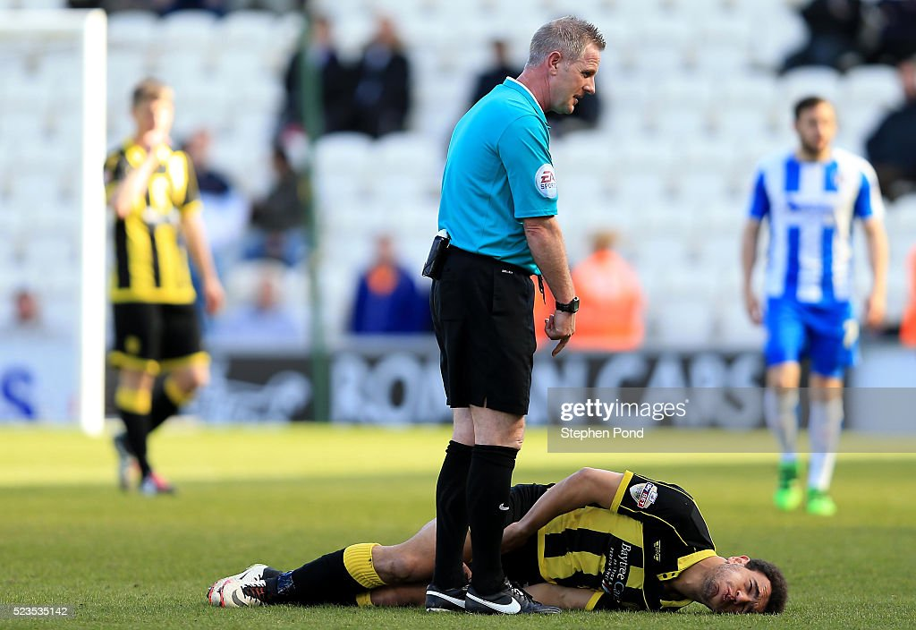 Mason Bennett of Burton Albion reacts prior to leaving the field on a stretcher during the Sky Bet League One match between Colchester United and Burton Albion at Colchester Community Stadium on April 23, 2016 in Colchester, England.