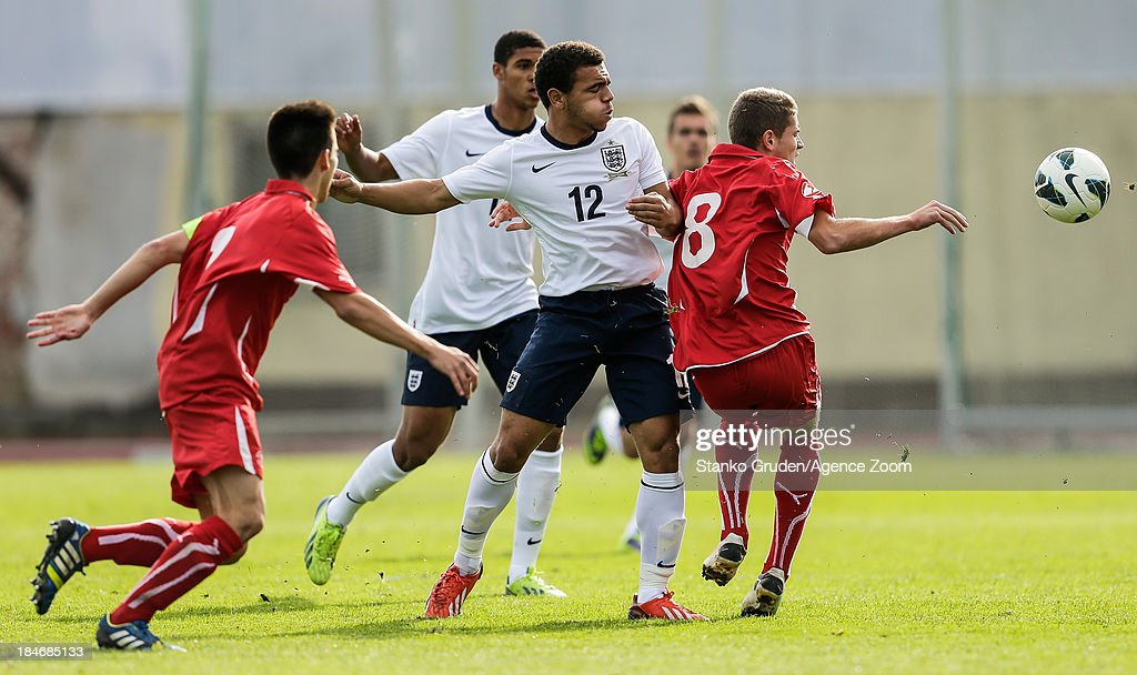 Mason Bennett of England and Mirsad Hasanovic of Switzerland during the UEFA U19 Championships Qualifier between England and Switzerland, on October 15, 2013 in Ptuj, Slovenia.