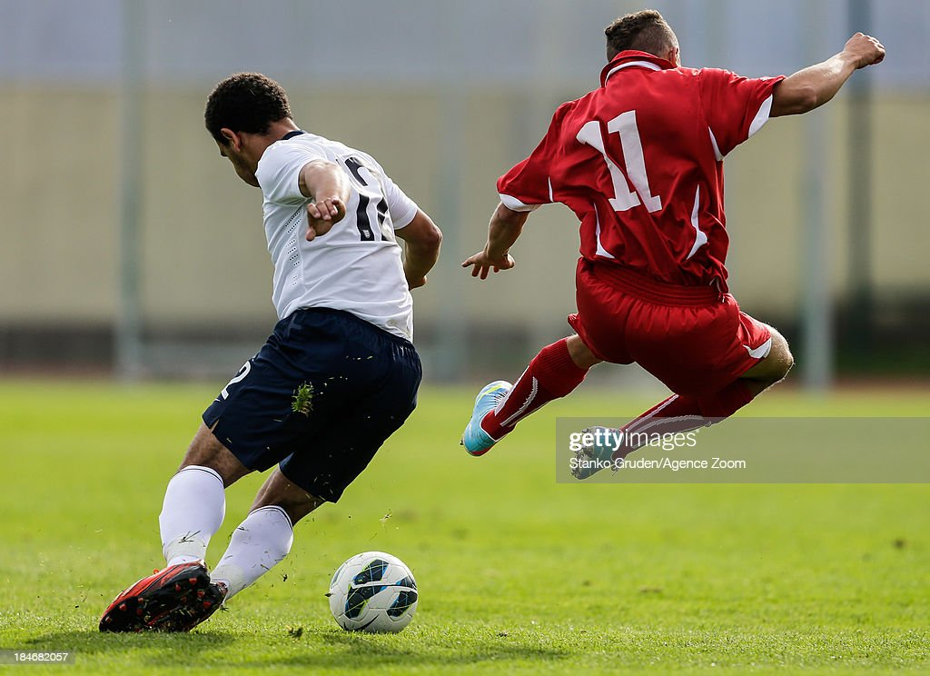 Mason Bennett of England and Omar Thali of Switzerland in action during the UEFA U19 Championships Qualifier between England and Switzerland, on October 15, 2013 in Ptuj, Slovenia.