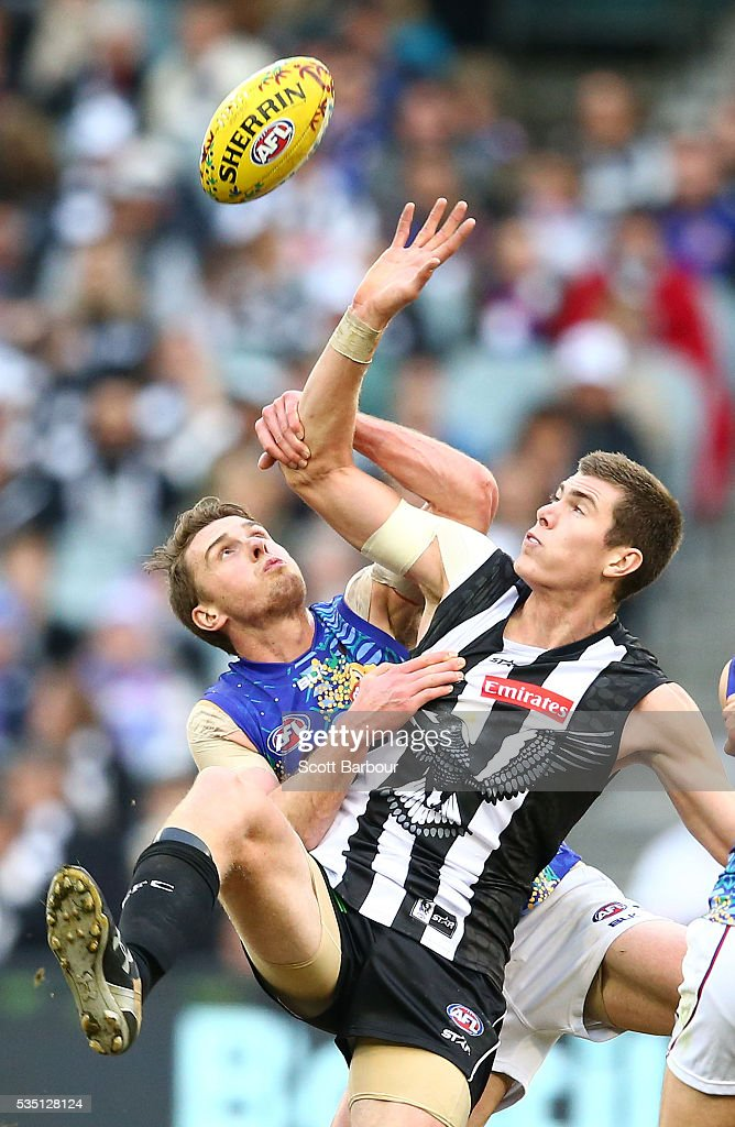 Mason Cox of the Magpies and Jordan Roughead of the Bulldogs compete for the ball during the round 10 AFL match between the Collingwood Magpies and the Western Bulldogs at Melbourne Cricket Ground on May 29, 2016 in Melbourne, Australia.