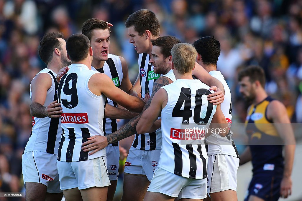 Mason Cox of the Magpies celebrates a goal with team mates during the round six AFL match between the West Coast Eagles and the Collingwood Magpies at Domain Stadium on May 1, 2016 in Perth, Australia.